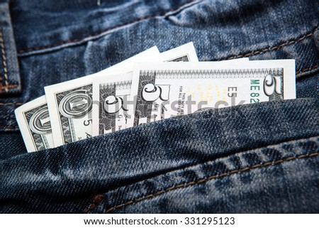 pocket costs in the form of dollars in your pocket - stock photo