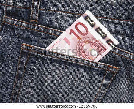 Pocket Money In Blue Jeans - Ten Euro Note - stock photo