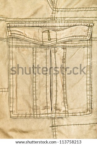 Pocket on a pair of khaki combat trousers - stock photo