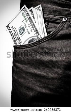 pocket pants stuffed with 100 Dollar bill - stock photo