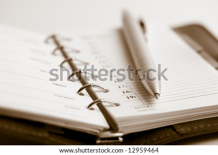 pocket planner and pen - stock photo