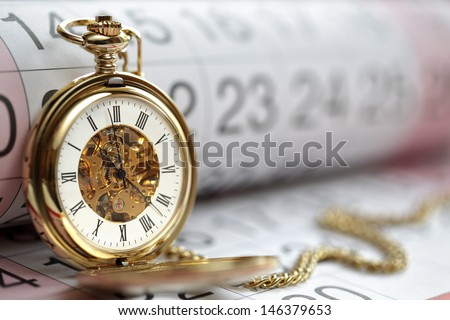 Pocket watch against a calendar concept for planning or scheduling - stock photo
