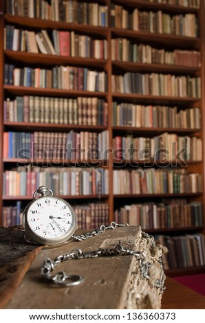 Pocket watch and books - stock photo