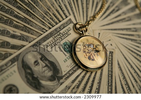 Pocket watch and money - stock photo