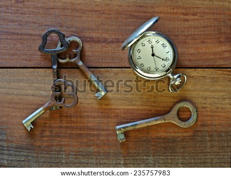 Pocket watch and old keys    - stock photo