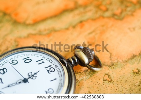 Pocket watch and old maps - stock photo