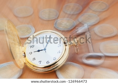 Pocket watch in focus on the background euro coins and keys. - stock photo