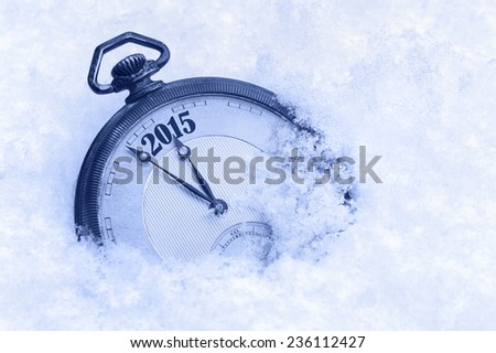 Pocket watch in snow, New Year 2015 greeting card - stock photo