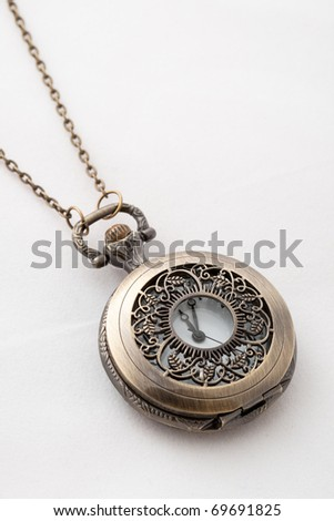 Pocket watch on a white background - stock photo