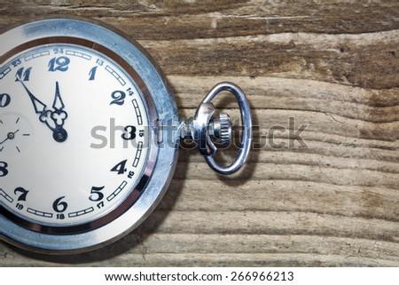 pocket watch on old wood, copy space - stock photo