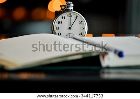 Pocket watch. symbols of time - stock photo