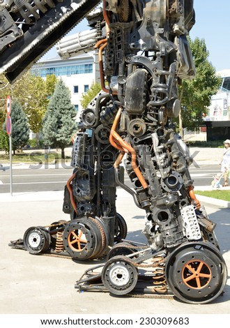 PODGORICA, MONTENEGRO-SEPTEMBER 09, 2014: A talented young artist Danilo Baletic has made several giant sized scrap metal sculptures inspired by Transformers robots  - stock photo