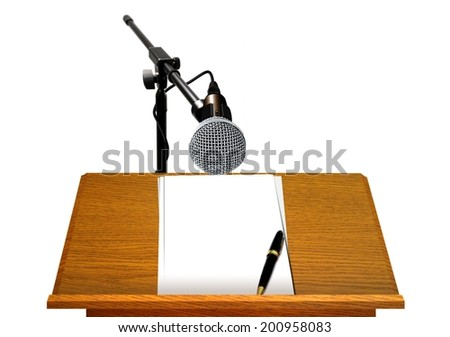 Podium with Microphone and Blank Papers - stock photo
