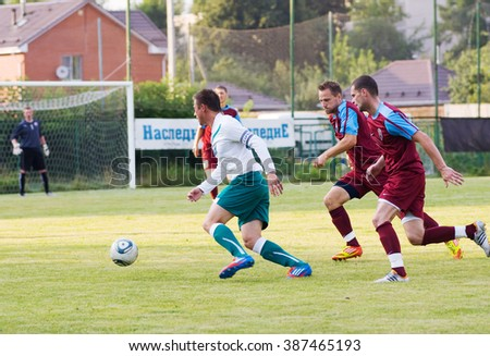 PODOLSK - JULY 12: Unidentified player in action during game Desna vs Podolsk of region football tournament - stock photo