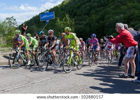 POGGIO ALLA CROCE, FIRENZE, ITALY - MAY 16: Main group climbing to gpm during the 11th stage of 2012 Giro d'Italia on May 16, 2012 in Poggio alla Croce, Firenze, Italy - stock photo