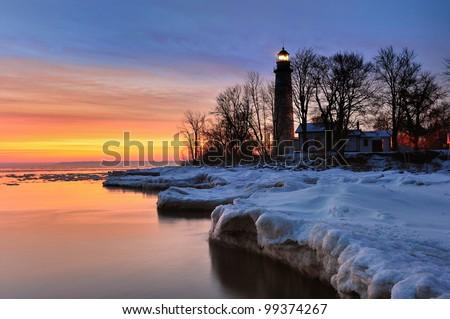 Point Aux Barques Lighthouse - Beautiful Winter Sunrise on Lake Huron  Port Hope, Michigan USA - stock photo