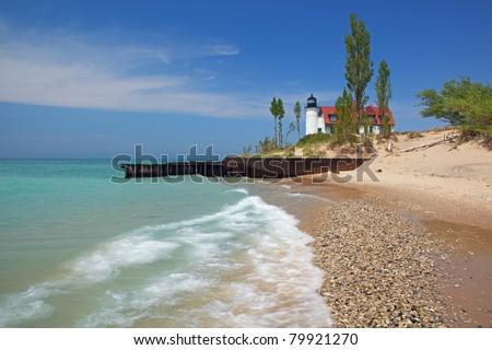 Point Betsie Lighthouse with splashing wave, Lake Michigan, Michigan, USA - stock photo