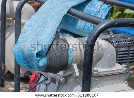 Point of the water pump with a rubber hose No.2 - stock photo