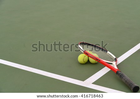 point of view tennis racket and balls on the tennis court - stock photo