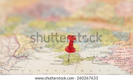 point on map concept: Simferopol pinned on the old Soviet map / partially out of focus, focus point on pushpin area - stock photo