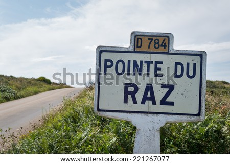 Pointe du Raz signal indication on the road. A rocky, dangerous point that extends into the Atlantic from western Brittany, France. - stock photo