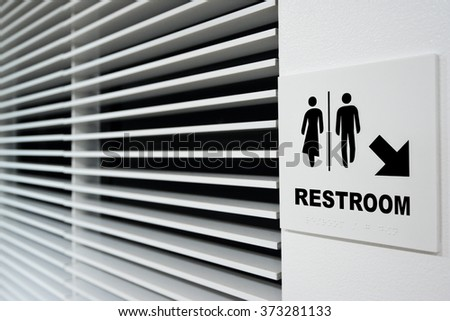 pointer directions to public restroom with arrow - stock photo