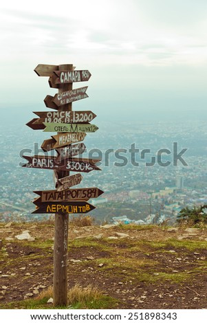 Pointers distances at mountain top  - stock photo