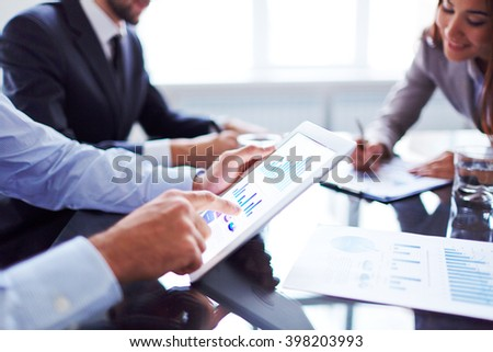 Pointing at chart - stock photo
