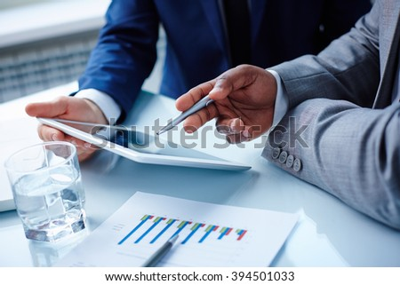 Pointing at touchscreen - stock photo