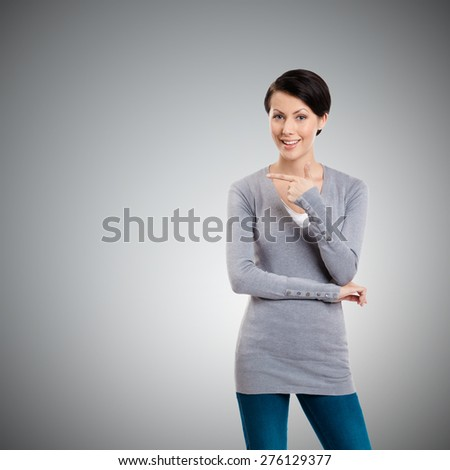 Pointing finger gesture, isolated on grey - stock photo