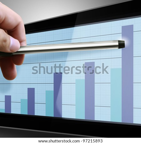 Pointing  graph on computer monitor - stock photo