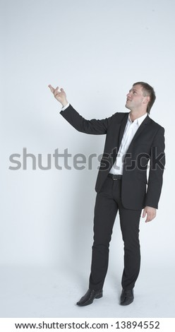Pointing into copy space - stock photo