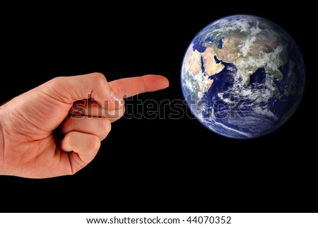 Pointing Towards Earth. Earth image courtesy of NASA Visible Earth: http://visibleearth.nasa.gov - stock photo