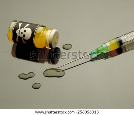poison and plastic syringe. Toxic ampule. - stock photo