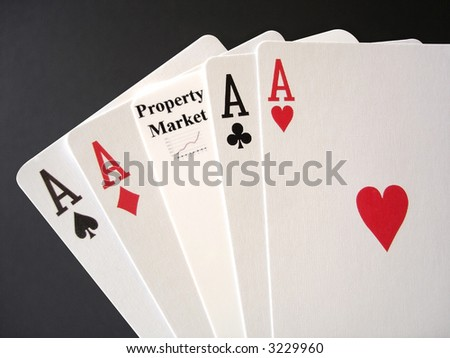 Poker Aces and a Property Market card for a gamble. - stock photo