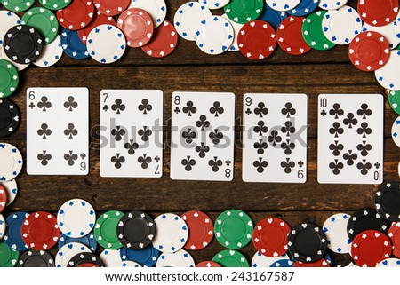 Poker cards and chips on wooden surface - stock photo