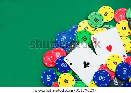 Poker cards and poker chips - stock photo