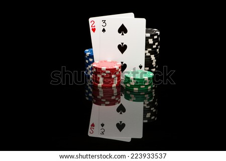 Poker cards on black background with reflexion - stock photo