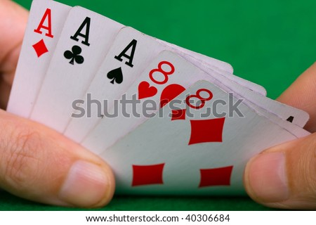 Poker cards showing a full house - stock photo