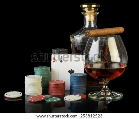 Poker chips and dollar bills on black cloth - stock photo