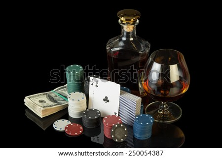 Poker chips and dollar bills on green cloth - stock photo