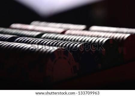 Poker chips in the dark - stock photo
