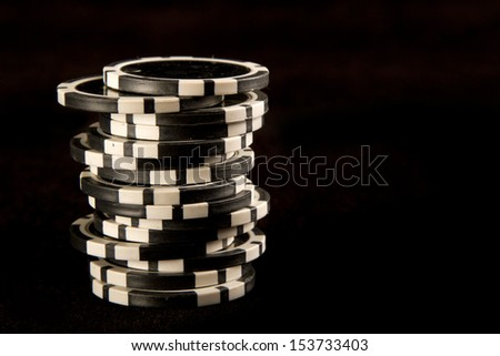 Poker chips on black background - stock photo