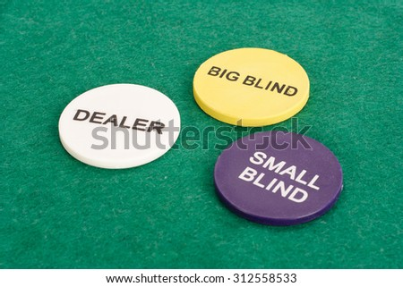 Poker chips on green cloth background - stock photo