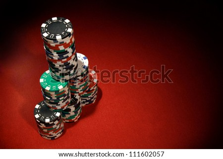 Poker chips on red background - stock photo