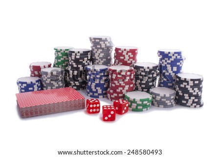 Poker chips whit cards and dices isolated on a white background - stock photo