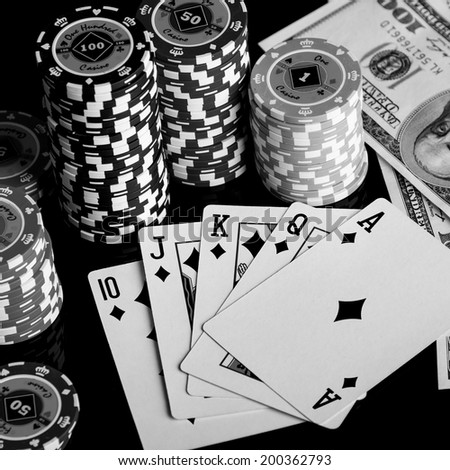 Poker Combination chips Playing cards and dollars in casino - stock photo