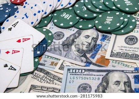 Poker Combination chips, playing cards and usa dollars bills in casino - stock photo
