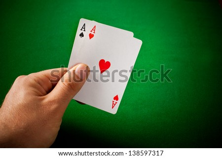 Poker concept with cards on green table - stock photo