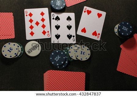 Poker play. Chips and cards,texas game. - stock photo